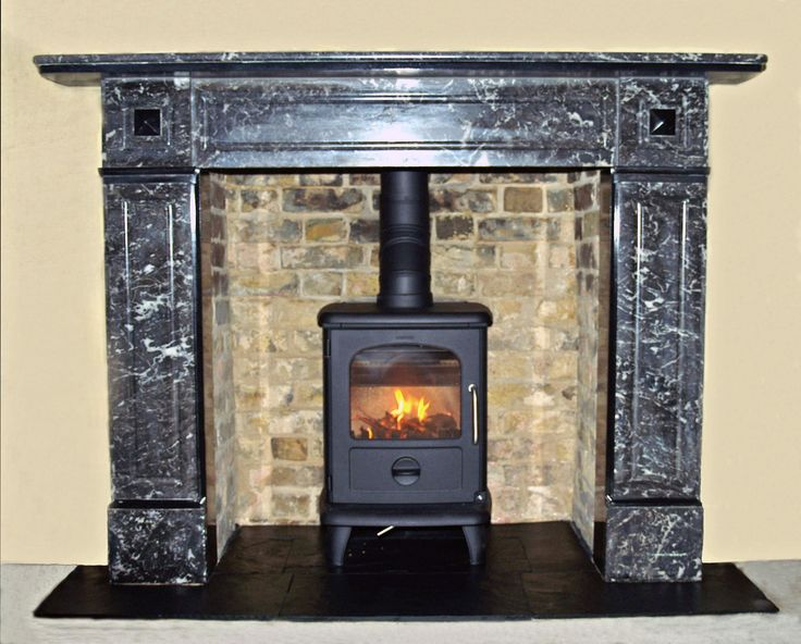 Original antique marble mantel, removed renovated and refitted with re pointed original brick chamber, slate tiled hearth and Morso 3112 badger wood stove, installed in Hackney, London E8 by Scarlett @ Design a fireplace 2004