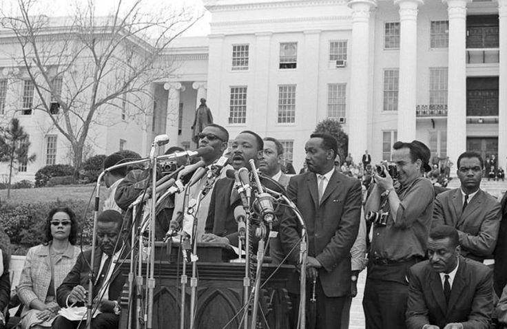 The Rev. Martin Luther King, Jr. addresses supporters and fellow marchers outside the State Capital
