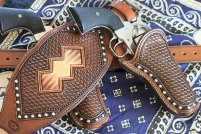 Mounted shooting holsters - example of inlay