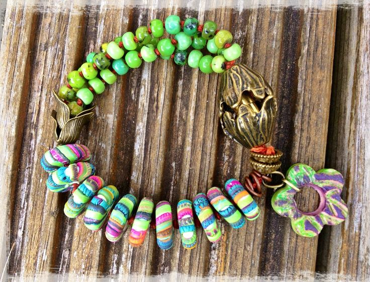 Handmade bracelet inspired by Heather Powers' hidden clasp bracelet tutorial. Chrysoprase, polymer clay disc beads by HappyDaysHandcraftedGiftware, polymer flower by Pips.