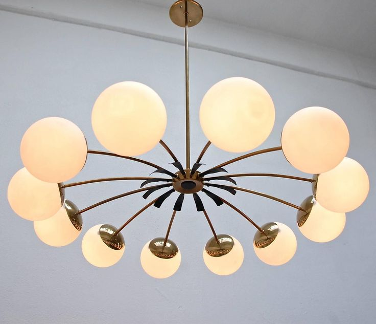 Twelve-Globe Italian Chandelier   From a unique collection of antique and modern chandeliers and pendants at https://www.1stdibs.com/furniture/lighting/chandeliers-pendant-lights/