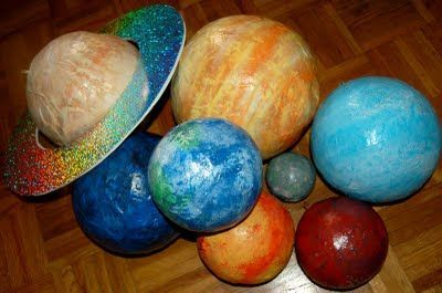 Paper Mache planets to decorate - but for play I need 2 GIANT paper mache planets to cover kids. Paper mache an exercise ball and cut out leg and head holes!