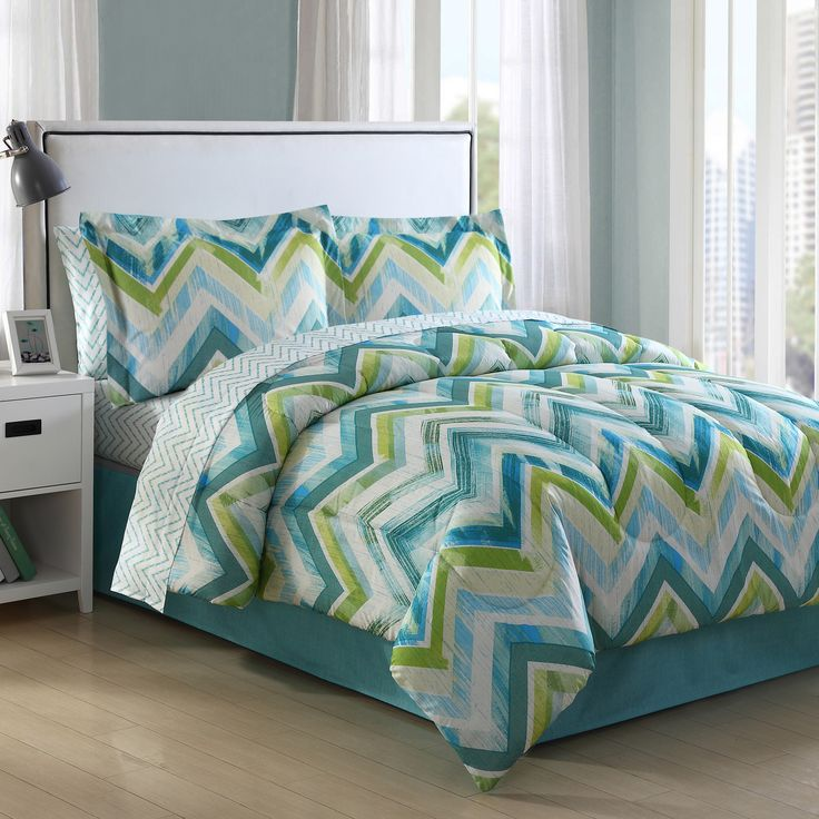 Connor Chevron offers bold horizontal chevron designs of lime green and two shades of blue. The chevrons are printed on a white ground and are of the contemporary water color technique.