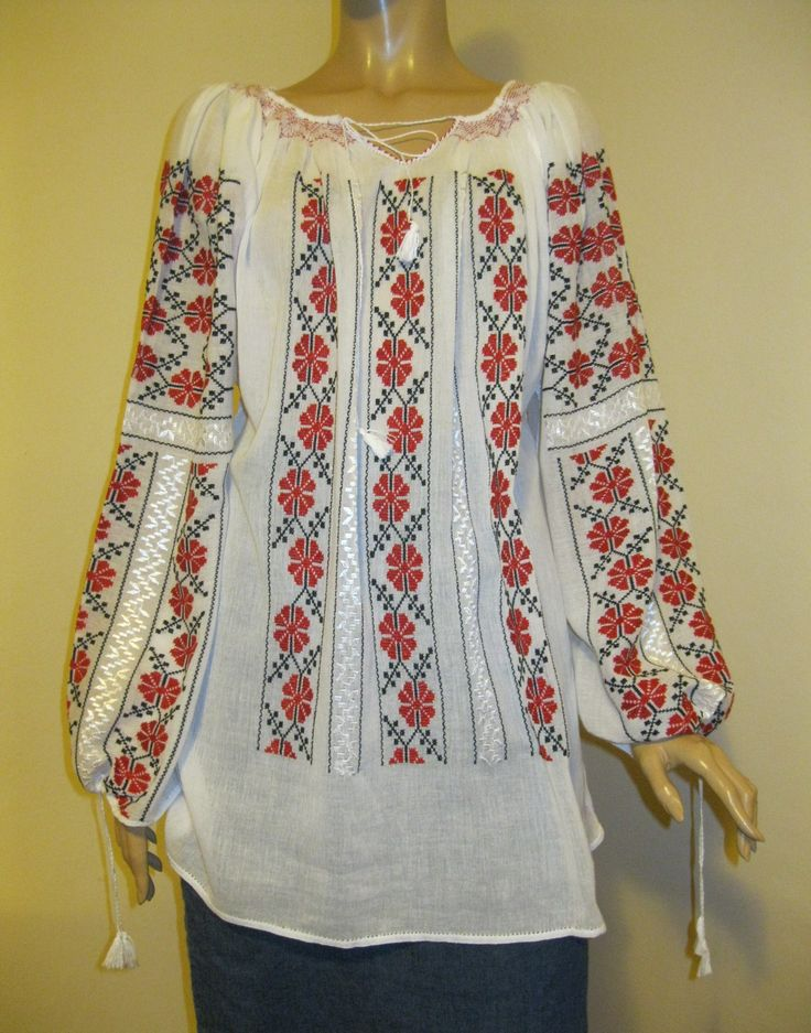 Stunning hand made Romanian peasant blouse, hand embroidered with red and black cotton thread on white very fine gauze cotton. Beautiful detailed with silk hand embroidery. Embroidered on the finest and sheer white gauze cotton.  Available at www.greatblouses.com