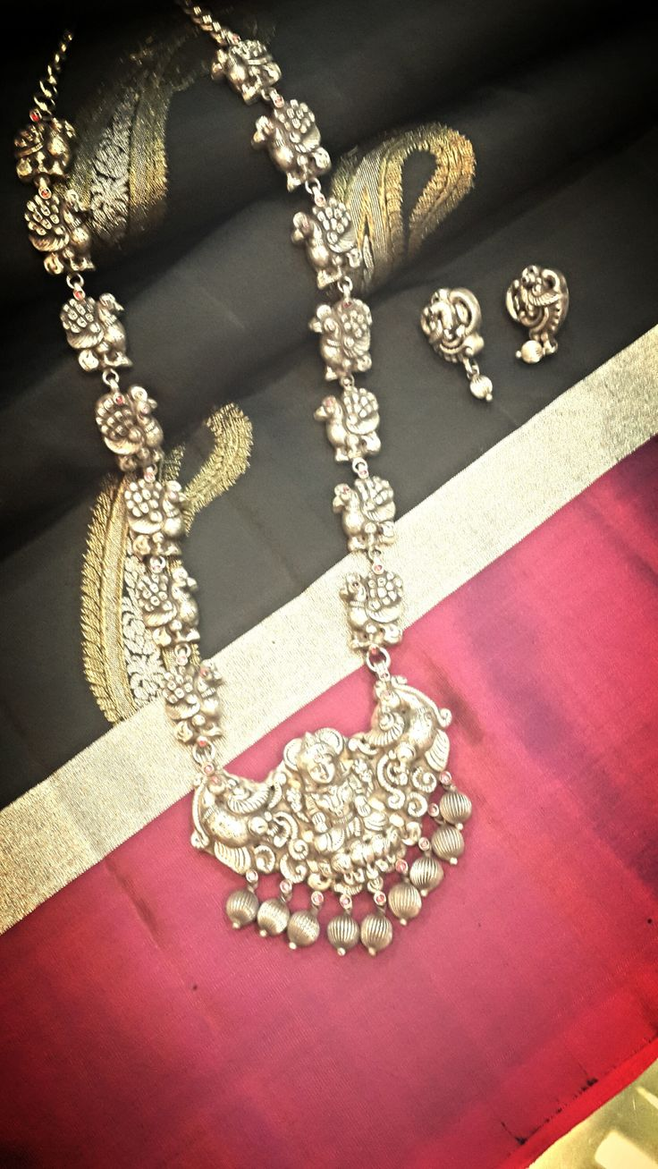 Pretty temple jewellery. Love the statement long chain