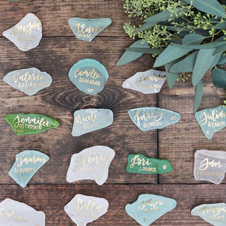 "Swooning over these sea glass place ""cards"". Love the look of translucent pastel pieces with guest names written in a metallic script!"