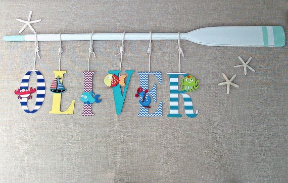 """59"""" Oar White Distressed with Teal Beach Glass Stripes and Personalized with Six (6) 9"""" Baby Name Letters in stripes chevrons solids by seaweeddesigns. Explore more products on http://seaweeddesigns.etsy.com"""