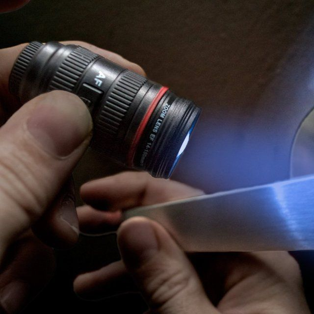 It's a replica of a 14-150mm camera lens and that's exactly why photographers would love the Camera Lens Light Up Keychain.