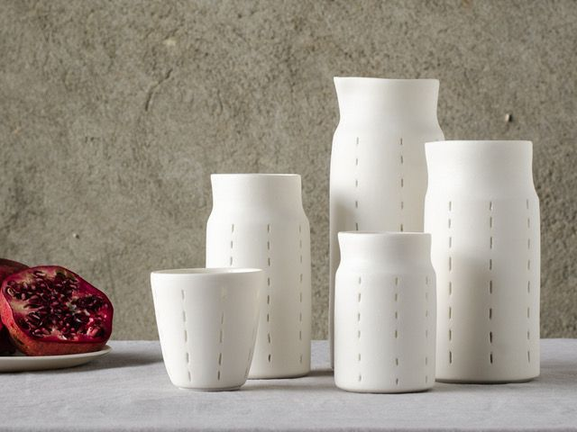 Non-transparency collection. Wheelthrown porcelain perforated and closed again, using the Rice-grain technique. Jharberink Porcelain