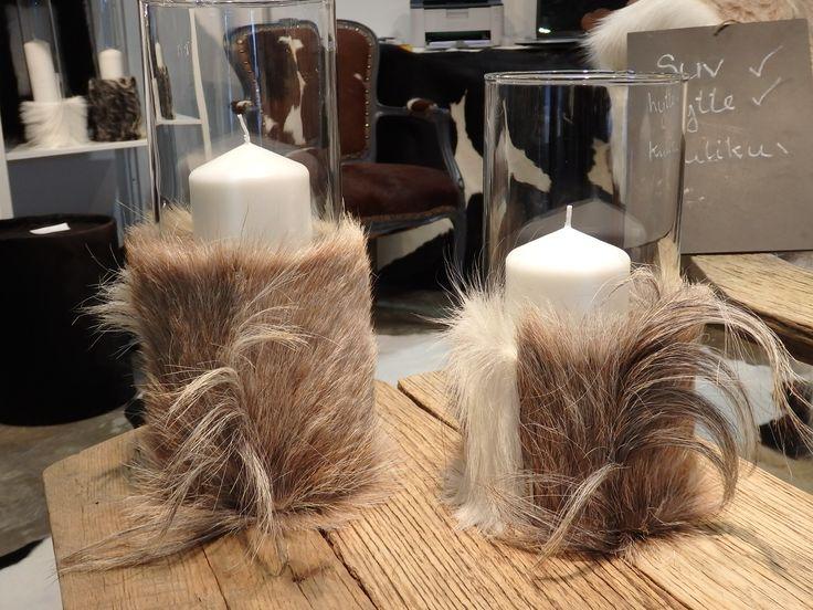 So cool..... candle sticks coverred in Norwegian goat. Made in Bergen. www,kuliku.no