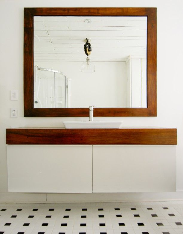 IKEA GODMORGON with DIY wooden countertop. Really lovely. I would however put two sinks in there.