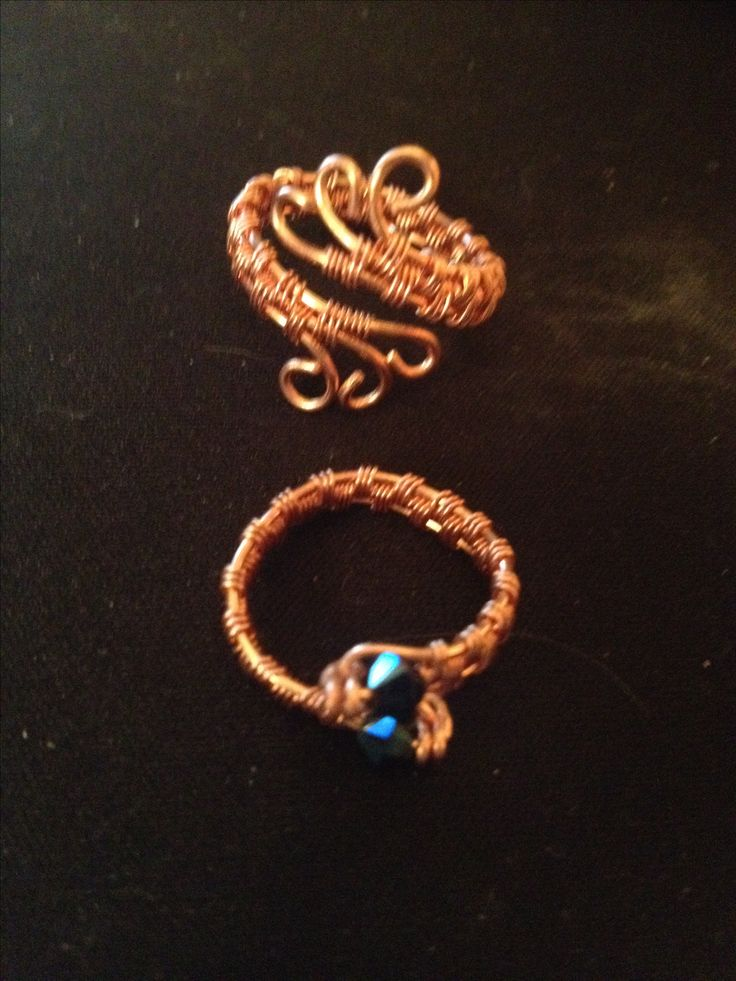 Two adjustable pure copper rings.  There are two Swarovski crystals in the bottom ring.