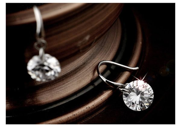 **** FREE SHIPPING **** Sterling Silver Earrings holding a Naked 2.0 Carat Round Swarovski Element crystal. These absolutely amazing earrings can be worn or given. Feshionn IOBI, Jewelry, purchase, buy, sale, shopping