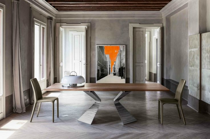 Bonaldo Prora table  A styling mark of absolute identity and easy to recognise: Prora is a table with legs that recall the shape of a ship's bow.  Prora is a table available both in the fixed or extending versions.  http://www.industryinterior.com/en/prod/living-room/table/bonaldo-prora-table.html