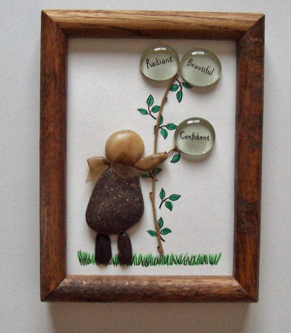 This is a lovely piece of rock & pebble framed art depicting a person holding on to a tree branch with clear gems and the words Radiant, Beautiful and Confident under each gem. A delightful grass image is painted and colored to bring whimsy to the piece. Notice the ribbon bow at the neck line?  I love rocks and pebbles and this is a perfect way to bring life to my collection for your enjoyment. These pebbles and rocks are hand picked by myself from Colorado lakes, streams and mountains. R...