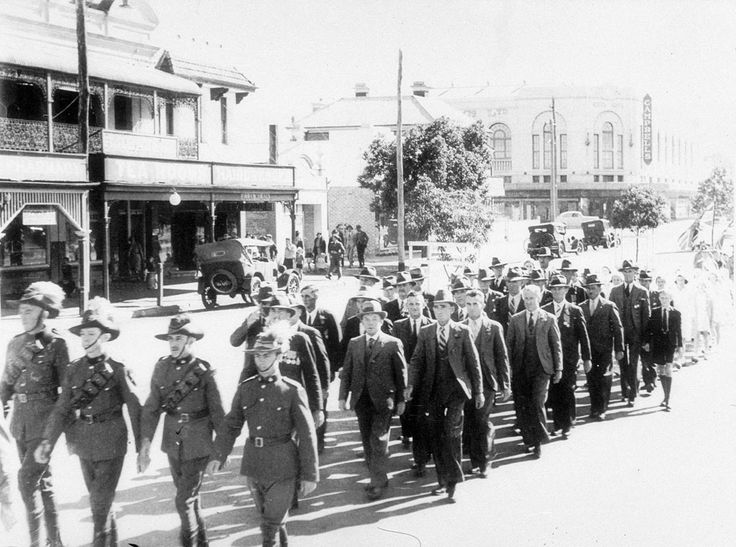 Anzac Day Parade. Headed by members of a light horse troop. Returned servicemen of Scone and District march along Kelly Street towards the War Memorial at the School of Arts in Scone, New South Wales : http://www.acmssearch.sl.nsw.gov.au/search/itemDetailPaged.cgi?itemID=391997