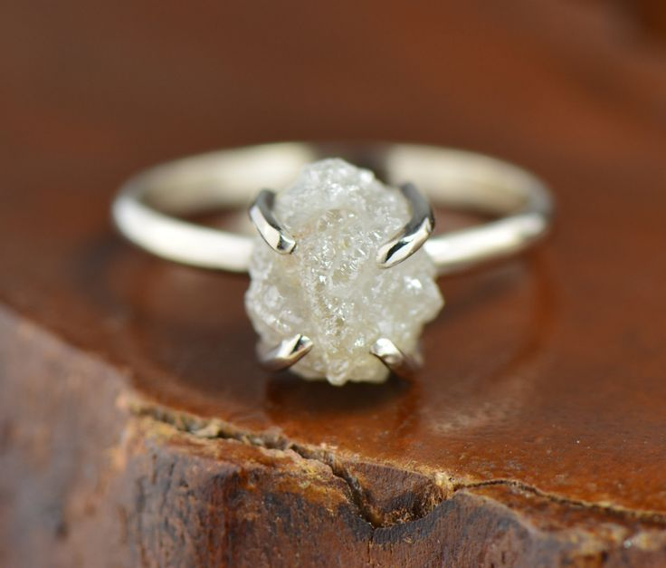 Uncut raw diamond engagement ring in white gold setting. Shop this one on Etsy.