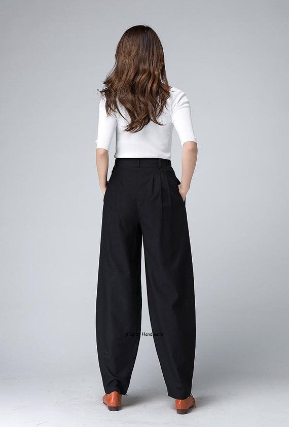 This Black pegged pants is crafted in soft black linen , featuring a fitted waist with pleated detail , two pockets on both side. Wear This vintage and retro inspired long pants and enjoy your casual weekend.  DETAIL * Black linen maxi pants * A zipper and a buttons in the front side * Side pockets on each side * You can tie a belt when you wear it * Suit for spring,fall,winter * Length approx 100 cm * you can choose any color from our fabric swatch https://www.etsy.com/listing...