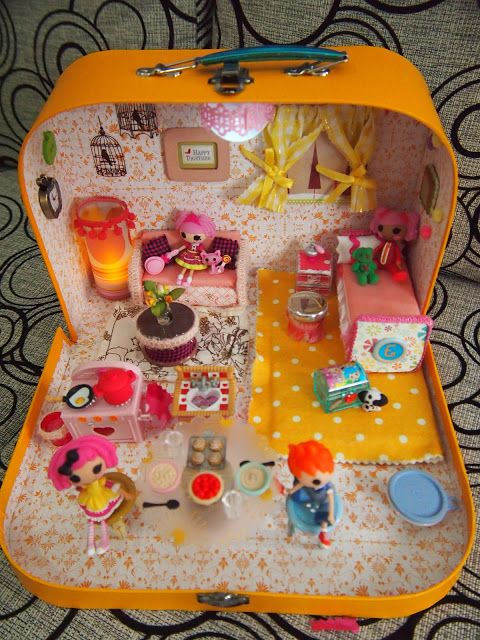 DIY Lalaloopsy dollhouse:  Close-up pictures & materials list to make each item.  Made from a lunch box.  Scrappalific   You could super size it with a suitcase from a goodwill and make it for the big lalaloopsy dolls :) Christmas gift for my sister ;)