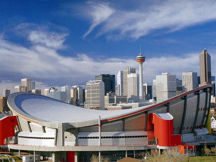 The Olympic Saddledome with the Calgary Tower and downtown behind.