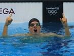 Daniel Gyurta of Hungary celebrates gold in the men's 200m Breaststroke