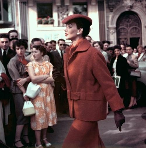 """Turning Heads"" Model Dorian Leigh wearing a smart deep rust suit, 1954."