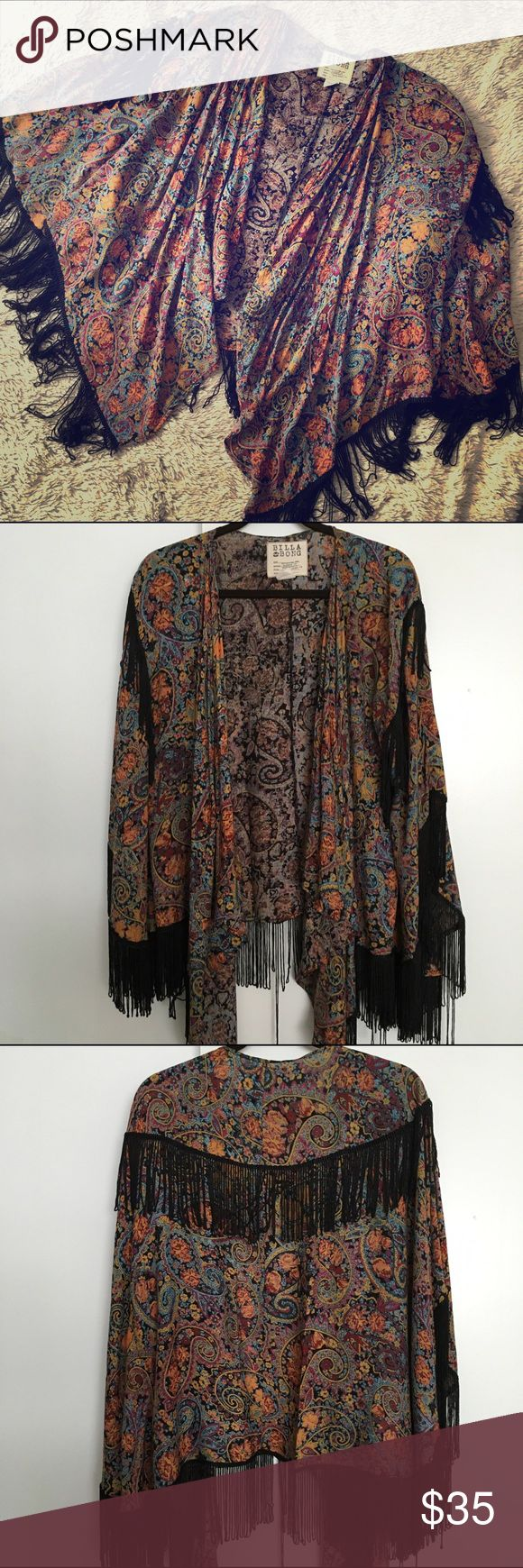 Paisley Print Fringe Kimono by Billabong Paisley print kimono by Billabong.  Has black fringe along the hem and shoulders onto the back.  In excellent condition apart from a few stretched out pieces of fringe.  Can be removed and no one would even know.  Boho Chic!!! Billabong Sweaters Shrugs & Ponchos