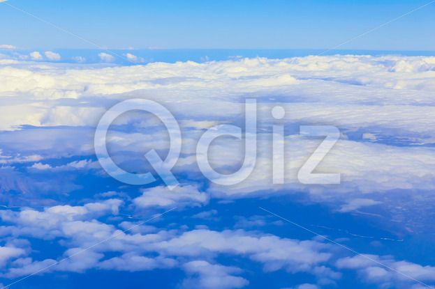 Qdiz Stock Images View on sky above clouds,  #above #aerial #air #atmosphere #background #blue #cloud #cloudscape #cloudy #color #day #flight #fly #heaven #hight #horizon #nature #over #sky #skyline #space #top #view #white