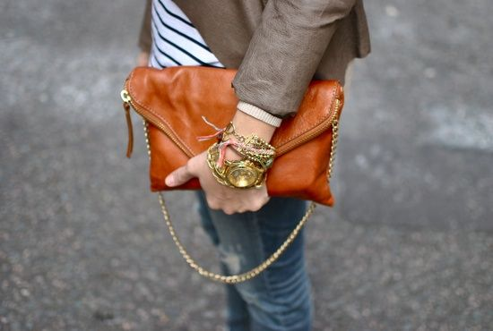 Chunky watch + lots of bracelets = win. (That handbag looks soft as buttah, too.)
