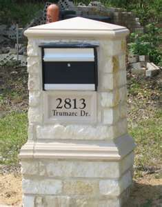 stone mailbox with plaque