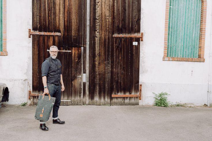 bruno streich wears a japanese denim waistcoat and a SANTORINI bag out of world war ll swiss army tent canvas and french army gunbelts. #streichbag #brunostreich #waistcoat #beard #beardmodel #saltandpepper #glasses #waistcoat #denim #selvedgedenim