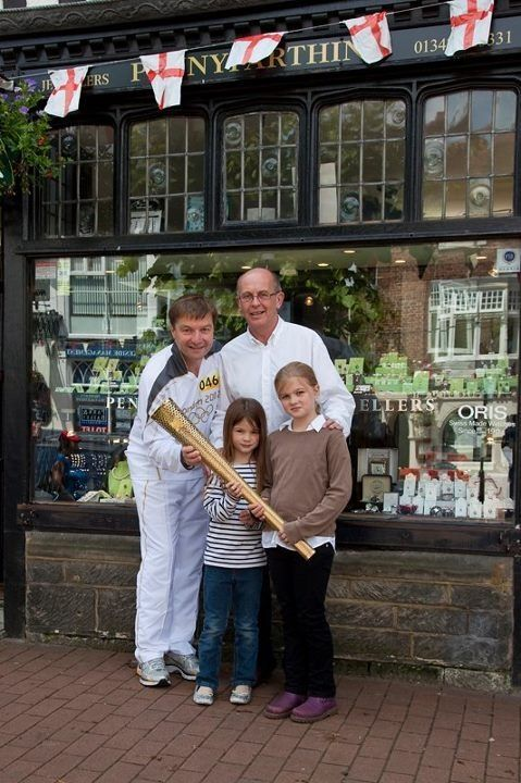 My  Girls with Richard Leman and the Olympic torch outside Penny Farthing