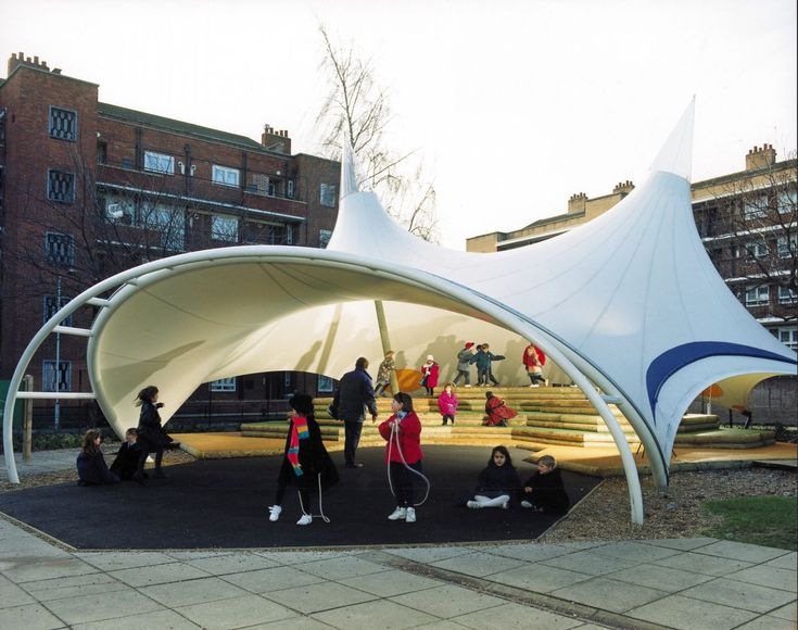 This modern twist to the covered play areas of Victorian schools is not only functional but also beautiful. Designed to provide shelter and performance space, the designers aimed to introduce the liberating spirit of the big top into the school environment. One writer described the outdoor structure as 'a fabulous white canvas bird floating above …