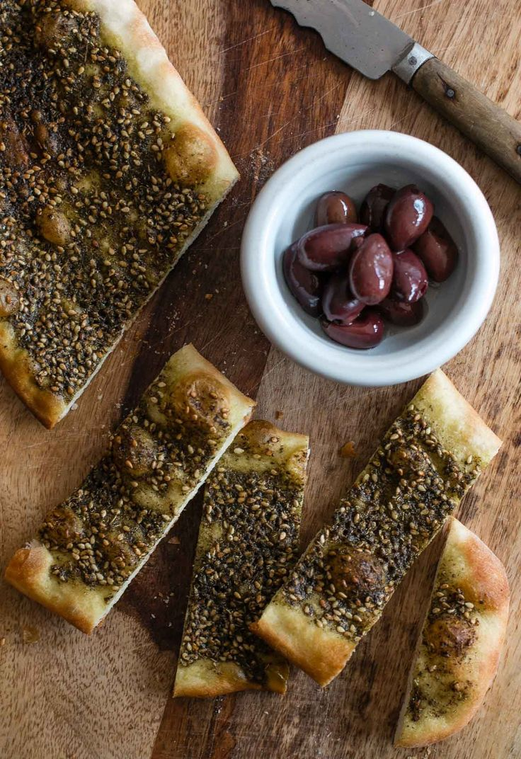 I've been thinking about man'oushe for years, ever since I went to Lebanon and someone handed me a warm flatbread right out of the wood-fired oven. It was the perfect snack: A warm, slightly supple dough slathered with za'atar, an herbaceous seasoning blend punctuated with sumac and sesame seeds.