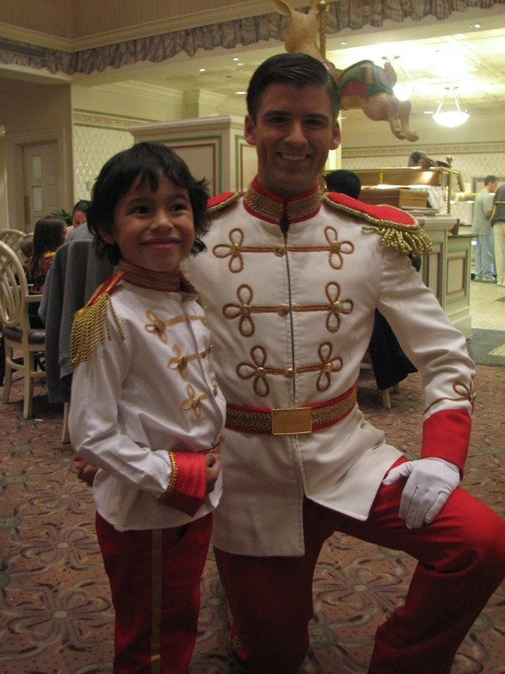 How totally cute!  Makes me wish I had a little boy.  I actually met this Prince Charming when we were there in Dec 2010.  He is good-looking!!