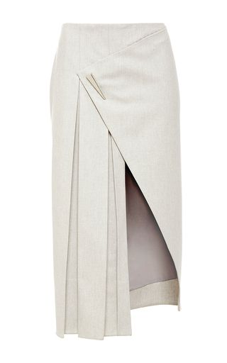 Rendered in cashmere wool flannel, this **Prabal Gurung** skirt features a medium rise with a wraparound design at the front, box pleats down one side and a cutaway knee length hem.