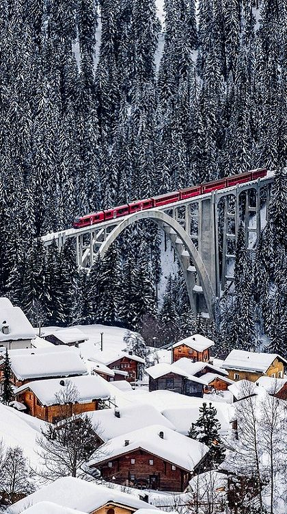 Rhaetian Railway on the viaduct of Long Meadow, (Albula/Bemina landscapes) Grisons, in the Alps between Switzerland and ITALY (Photo by ehutphoto)
