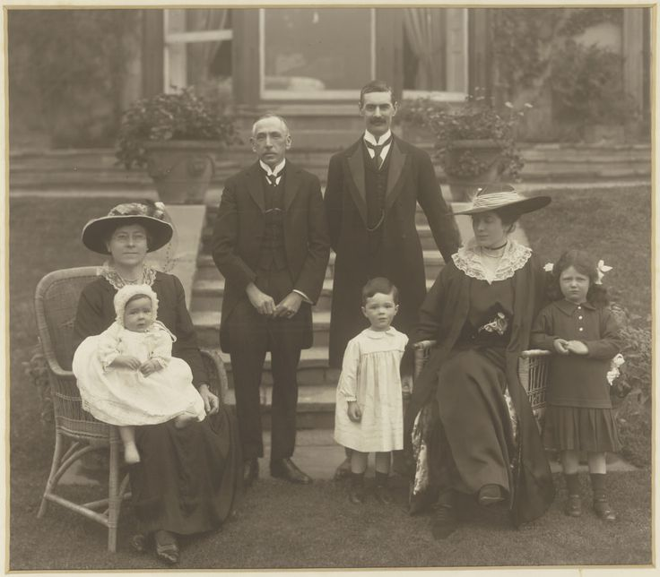 All sizes | W.M. Hughes, his wife Mary with baby Helen and Neville Chamberlain and his family in Birmingham, England in May 1916 | Flickr - Photo Sharing!