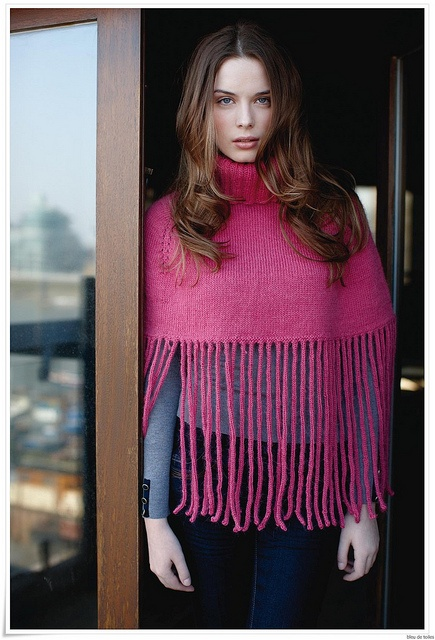 Rowan | Knitted poncho with what looks like hanging i-cords instead of fringe, much sleeker
