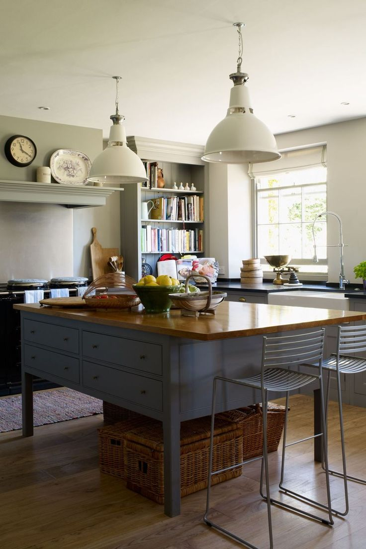 """The kitchen is by [link url=""""http://www.plainenglishdesign.co.uk/""""]Plain English[/link], and the industrial-looking pendant lights above the island were salvaged from an old Rover car factory, however similar styles can be found at [link url=""""http://www.originalbtc.com/""""]Original BTC[/link]."""