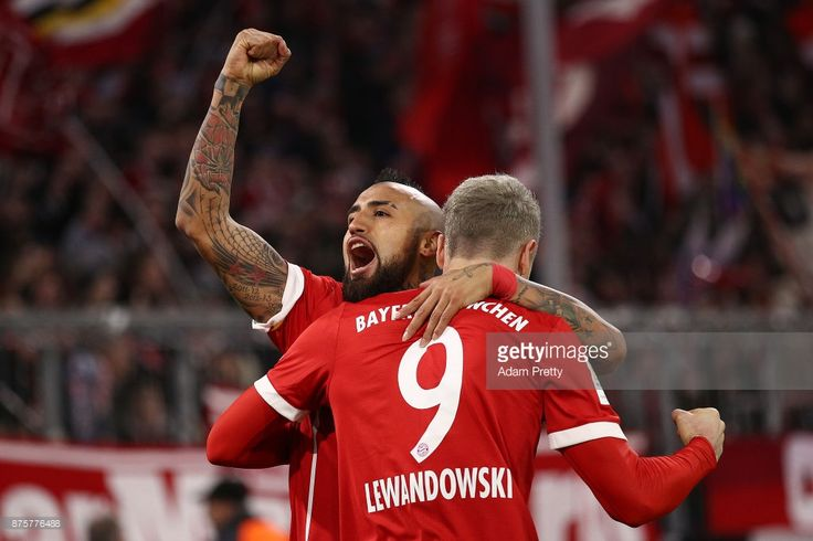 Robert Lewandowski of Bayern Muenchen (r) celebrates with Arturo Vidal of Bayern Muenchen after he scored his teams third goal to make it 3:0 during the Bundesliga match between FC Bayern Muenchen and FC Augsburg at Allianz Arena on November 18, 2017 in Munich, Germany. (Photo by Adam Pretty/Bongarts/Getty Images)