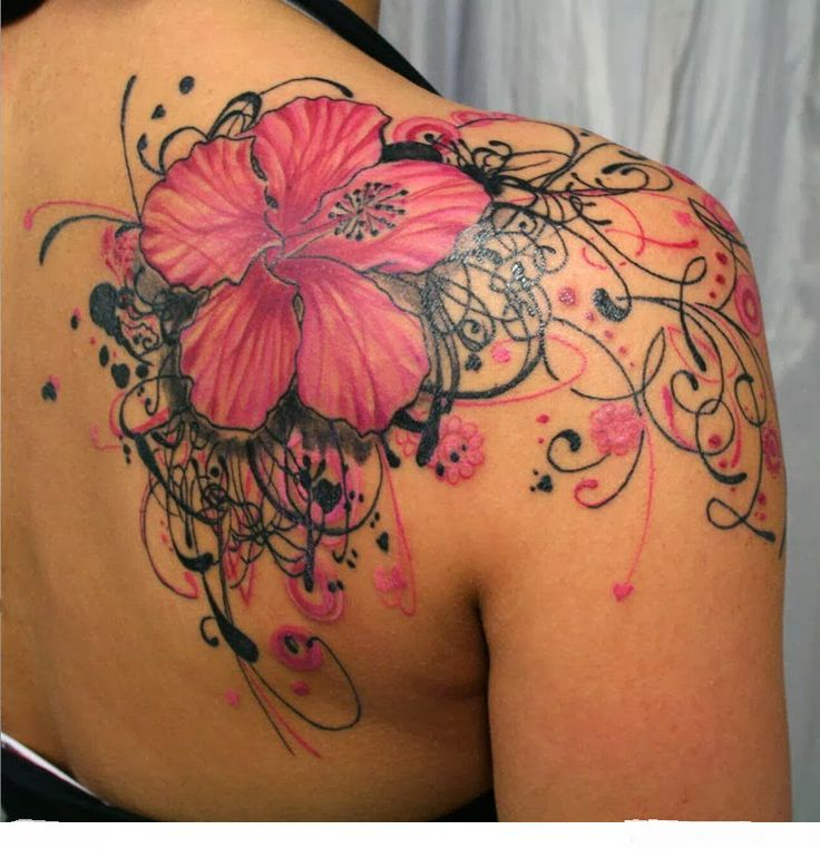 Pink flowers tattoo on the shoulder