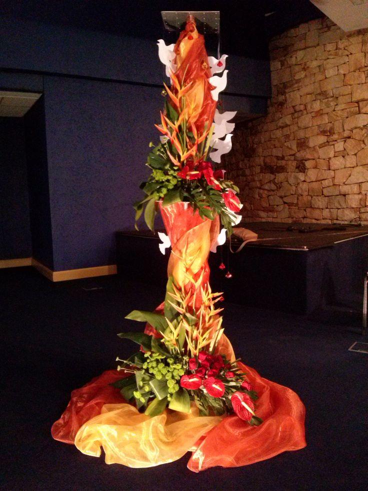 Pentecost flower arrangement- red/orange symbolizing fire and white doves the Holy Spirit.