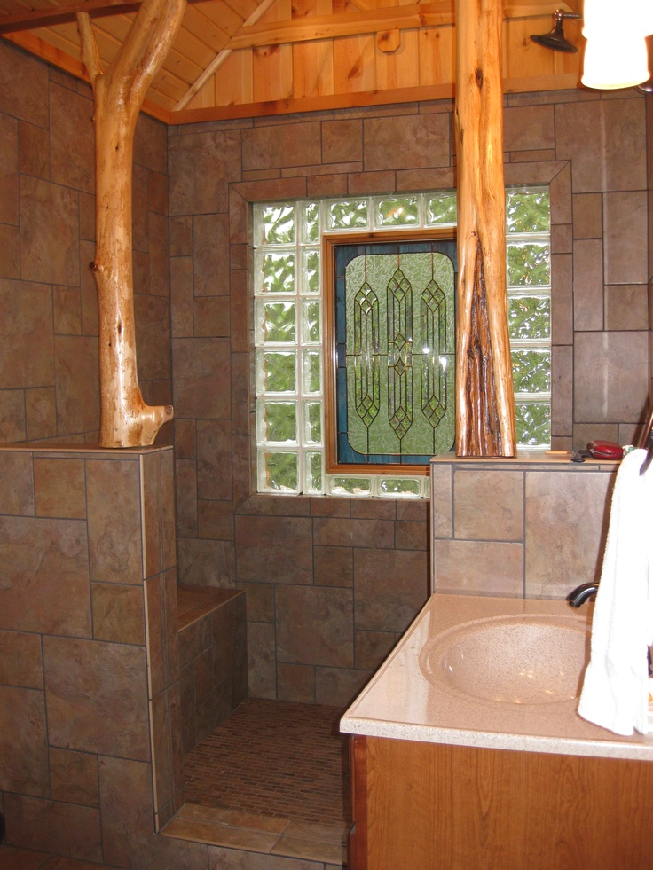 Use the existing arch & knee walls to section off the shower/toilet area?