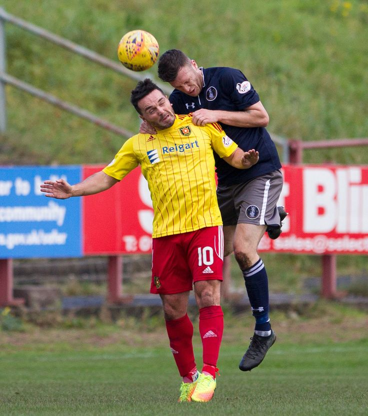 Queen's Park's Adam Cummins heads clear during the SPFL League One game between Albion Rovers and Queen's Park.
