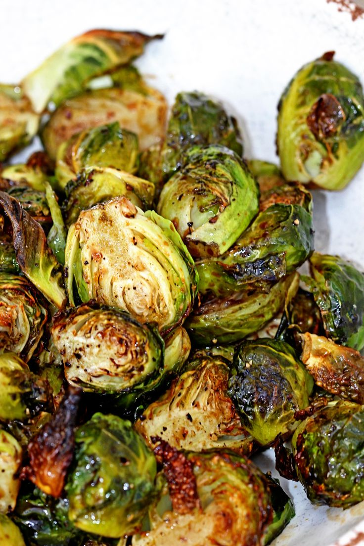 Roasted Brussels Sprouts with balsamic and honey (replace honey with maple syrup?)