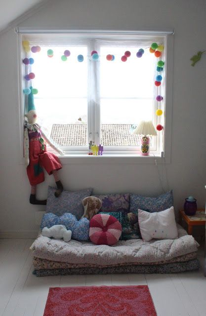 Pompoms and pillows would make a nice reading area