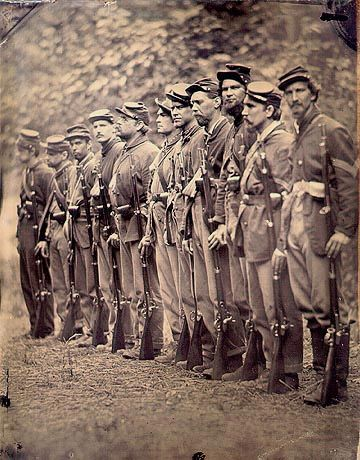 A rare image . . . from the look of these soldiers this is a late civil War photo of a battle-hardened company. A company would have started with around 100 men, there were no replacements. After a hard campaign between caualties and disease this is what might be left  . . .