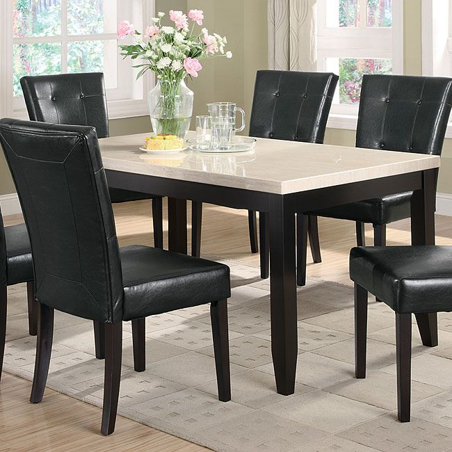 Elegant, clean and modern in design, this Anisa Dining Table w/ Cream Faux Marble Top by Coaster Furniture is a sleek addition to any eating area in your home. Featuring a Dark Cappuccino finish, straight tapered legs, and light faux marble top, this table is a functional and smart furniture choice for your home. Pair this piece with the coordinating side chairs for a gathering grouping in your home.