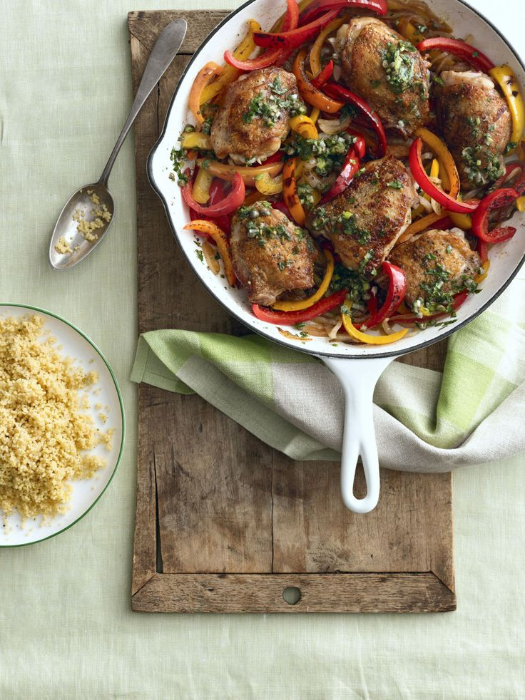 Spice up your weeknight dinner with this quick and easy chicken recipe. Recipe: Crispy Chicken Thighs with Peppers and Salsa Verde    - CountryLiving.com